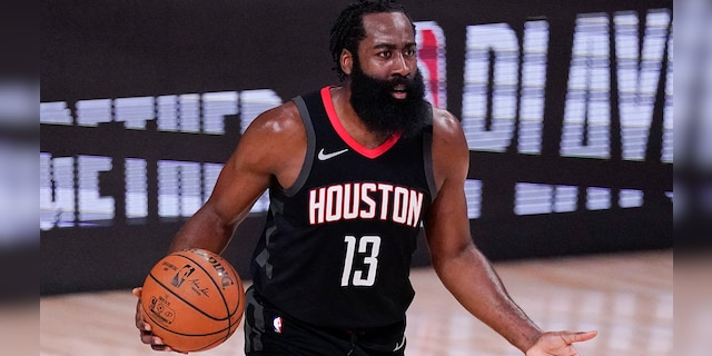 In this Sept. 12, 2020, file photo, the Houston Rockets' James Harden argues a call during the first half of an NBA Western Conference semifinal playoff basketball game against the Los Angeles Lakers in Lake Buena Vista, Fla. (AP Photo/Mark J. Terrill, File)