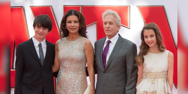 Catherine Zeta-Jones and Michael Douglas with their children Dylan, 20, and Carys, 17. (Photo by Julian Parker/UK Press via Getty Images)