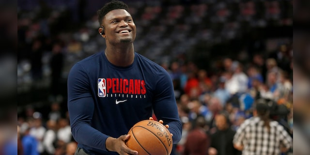 In this March 4, 2020, file photo, New Orleans Pelicans forward Zion Williamson shoots free throws prior to an NBA basketball game against the Dallas Mavericks in Dallas. (AP Photo/Michael Ainsworth)