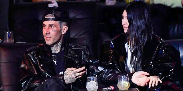 Travis Barker and Kourtney Kardashian are seen in attendance during the UFC 260 event at UFC APEX on March 27, 2021 in Las Vegas, Nevada.