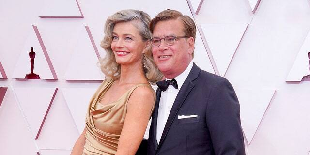 Paulina Porizkova and Aaron Sorkin attend the 93rd Annual Academy Awards at Union Station on April 25, 2021 in Los Angeles, California.