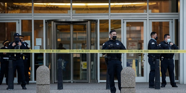 CHICAGO, IL - APRIL 15: Chicago Police officers guard the front entrance the their headquarters building during a rally on April 15, 2021 in Chicago, Illinois. (Photo by Kamil Krzaczynski/Getty Images)