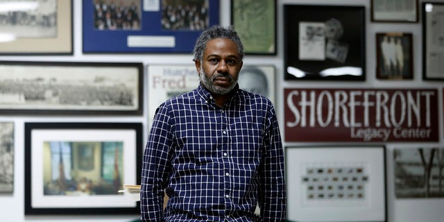 """Evanston's local historian Morris """"Dino"""" Robinson Jr., who co-authored a city-commissioned study on housing practices, poses for a portrait in Shorefront Legacy Center in Evanston, Ill., Friday, April 9, 2021."""