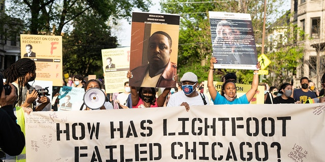 Demonstrators protest Chicago Mayor Lori Lightfoot on the second anniversary of the mayors time in office near her home in the Logan Square neighborhood in Chicago, Illinois on May 20, 2021. (Photo by Max Herman/NurPhoto via Getty Images)