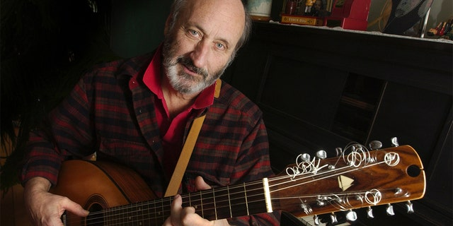 Noel Paul Stookey shows off a 12 string guitar custom-made by a Maine artisan, circa 2003. Stookey spends much of his time at his home in Blue Hill, Maine.