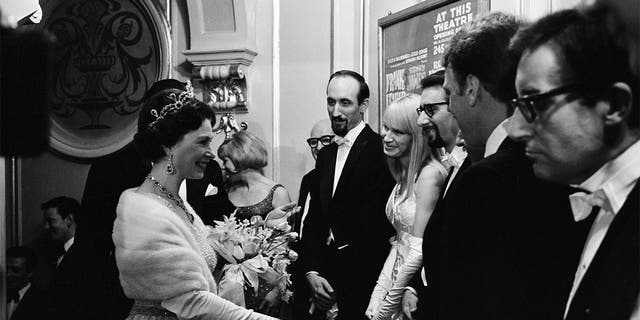 Royal Variety Performance, London Palladium, 8th November 1965. Queen Elizabeth II makes her way down the presentation line. Meeting folk singers Peter, Paul and Mary, and actor-comedian Peter Sellers.