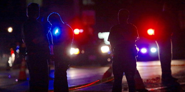 Investigators at the scene of a police-involved shooting on Wednesday, July 6, 2016, in Falcon Heights, Minn.