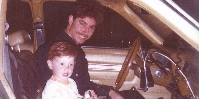 Officer Michael Pavelka and young Matthew Pavelka.