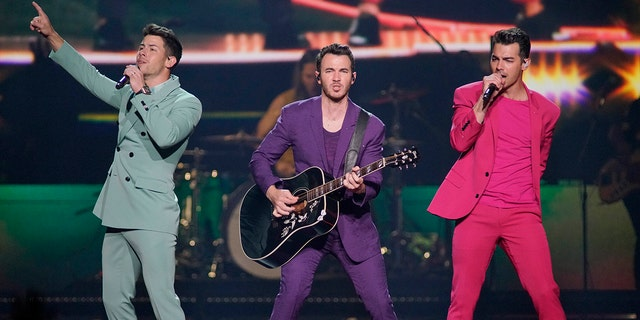 "Nick Jonas, Kevin Jonas, and Joe Jonas, of the Jonas Brothers, performing during their ""Happiness Begins Tour"" in Chicago."
