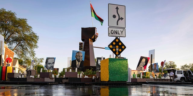 Tributes are seen where community members gather in George Floyd Square to demand justice for Winston Boogie Smith Jr., on Monday, June 7, 2021. Smith was fatally shot by members of a U.S. Marshals task force. (AP Photo/Christian Monterrosa)