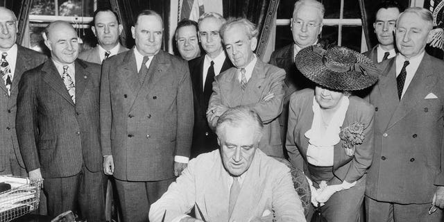 President Franklin Roosevelt signs the G.I.Bill of Rights, which provides broad benefits for veterans of World War II.