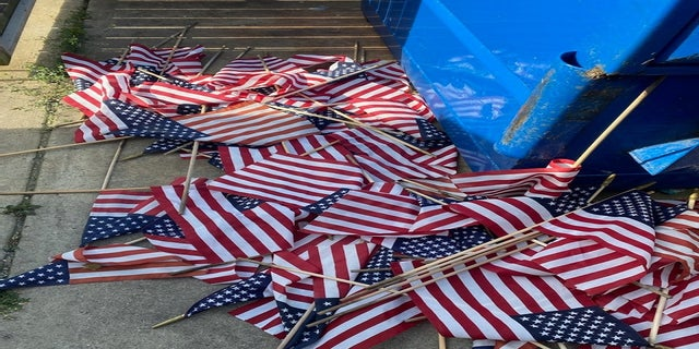 Some of the flags were left near a dumpster. (Courtesy VFW Post & Auxiliary #1138)