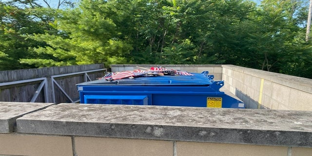 Other flags from the display, which is set to remain through the Fourth of July holiday, were placed on top of a dumpster near the facility. (Courtesy VFW Post & Auxiliary #1138)