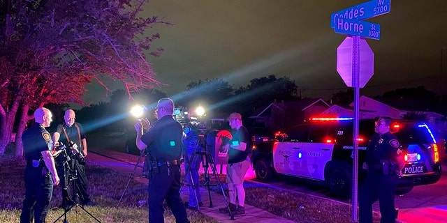 Fort Worth Police Chief Neil Noakes holds a news briefing at the site of a shooting early Sunday, July 4, in Fort Worth, Texas. Multiple people were wounded early Sunday in a shooting near a Fort Worth car wash in which it appears multiple guns were used, police said. (Fort Worth Police Dept. via AP)