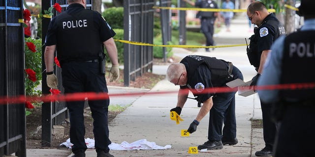 Police investigate a crime scene where three people were shot at the Wentworth Gardens housing complex in the Bridgeport neighborhood on June 23, 2021 in Chicago, Illinois. A 24-year-old man died from injuries he suffered in the shooting and two others, a 22-year-old male and a 25-year-old male, were seriously wounded.