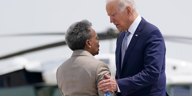 President Joe Biden greets Chicago Mayor Lori Lightfoot, as he arrives at O'Hare International Airport, Wednesday, July 7, 2021, in Chicago. (AP Photo/Evan Vucci)