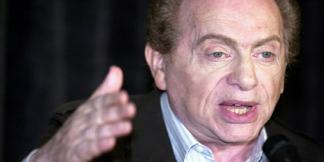 FILE - In this Wednesday, Aug 28, 2002, file photo, comic Jackie Mason addresses the media at Zanie's comedy club in Chicago about the club's decision to cancel comic Ray Hanania's appearance.