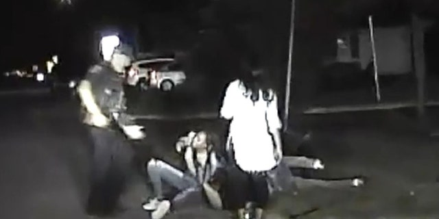 The dashcam video appeared to show two female suspects on top of the officer pinning him to the ground
