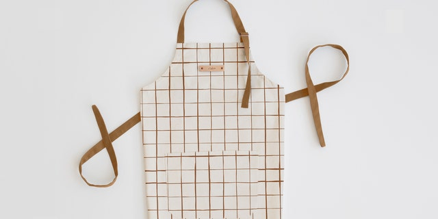 All aprons can be personalized with a name or monogram of your choice and two-day shipping is available if you didn't get around to shopping well in advance of party time.