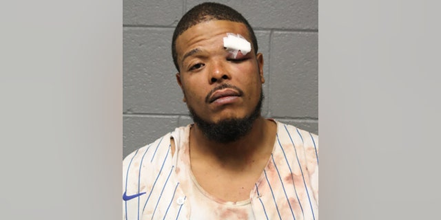Clark appears in a mug shot following his arrest Sunday. He faces a lead charge of aggravated assault on a peace officer.