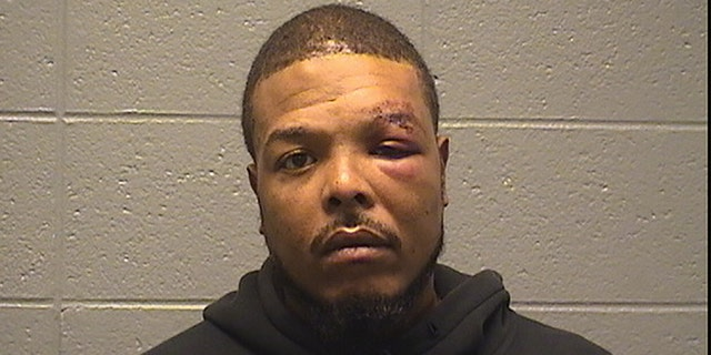 Clark, pictured above in a booking photo, was booked into the Cook County Jail and held on $100,000 bond.