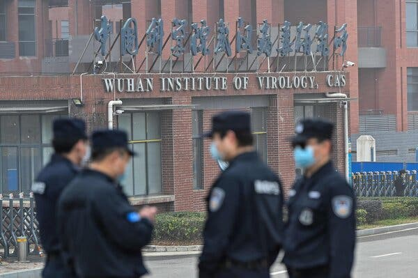 Security personnel standing guard outside the Wuhan Institute of Virology in Wuhan, China, in February.