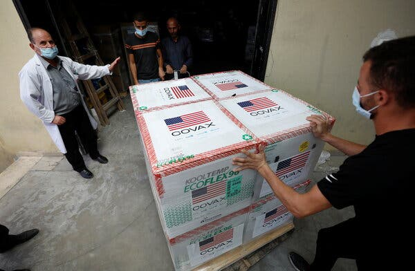 Palestinians receiving a shipment of coronavirus vaccine donated by the United States in the West Bank on Tuesday.