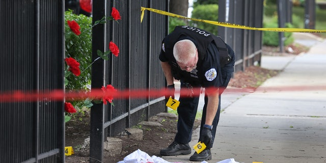 Chicago Police investigate a crime scene where three people were shot at the Wentworth Gardens housing complex in the Bridgeport neighborhood on June 23. The city reported 78 murders in August, a 22% jump compared to August 2020, the Chicago Police Department said Wednesday. (Photo by Scott Olson/Getty Images)