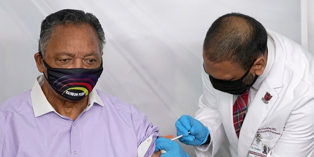 The Rev. Jesse Jackson receives the Pfizer-BioNTech COVID-19 vaccine from Dr. Kiran Chekka, Covid administration physician, at the Roseland Community Hospital in Chicago. (Associated Press)
