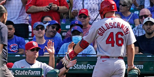 St. Louis Cardinals manager Mike Shildt, left, congratulates Paul Goldschmidt after Goldschmidt's solo home run during the third inning of a baseball game against the Chicago Cubs in Chicago, Sunday, Sept. 26, 2021.