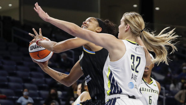 Cooper, Parker help Sky hold off Wings in playoff opener