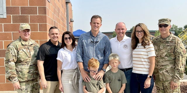 Rep. Moore with his boys, Utah's Governor and First Lady, Utah's Lieutenant Governor and Second Gentleman, and servicemembers at Utah's military family day celebration earlier this summer