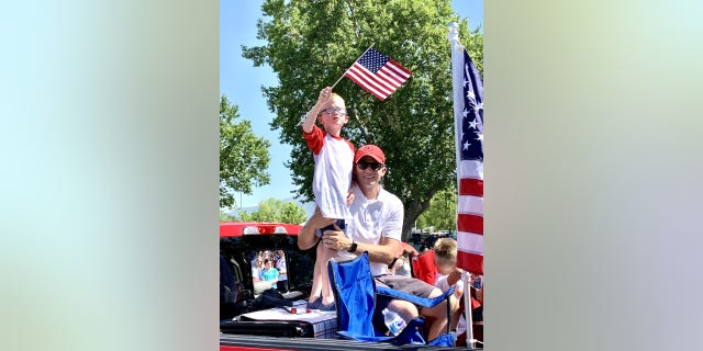 Rep. Moore and his son Winnie at the Kaysville Independence Day parade