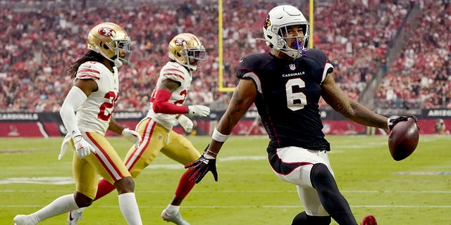 Arizona Cardinals running back James Conner (6) scores a touchdown against the San Francisco 49ers during the first half of an NFL football game, Sunday, Oct. 10, 2021, in Glendale, Arizona.
